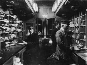 "Inside the postal compartment (""Rolling post offices""), 1904."